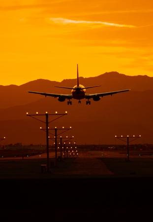 airborne: Airplane Travel at Sunset.  Stock Photo