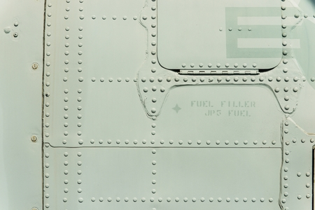 Military Metal with Small Metal Rivets. Armored Military Aircraft Metal Body Backdrop.