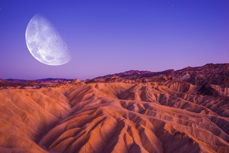 geological: Death Valley Moon Night. Death Valley Badlands Area. California, United States.