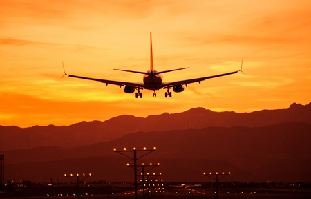 landing: Landing Airplane at Sunset. Las Vegas International Airport, Nevada, United States. Air Transportation Theme. Editorial
