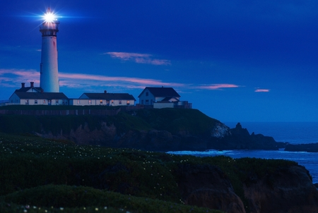 lighthouse with beam: Lighthouse Scenery at Night. Pigeon Point Lighthouse in California, United States. Pigeon Point Light Station Built in 1871.