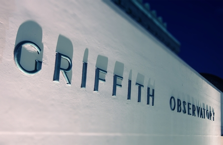 griffith: Griffith Observatory Wall Sign at Night. Los Angeles, California, United States.