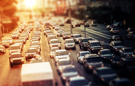 traffic: Highway Traffic at Sunset. Tilt Shift Concept Photo. Traffic in Las Vegas Nevada, USA.