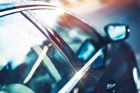 光沢のある透明な小型車ボディ。車のクローズ アップ写真。 写真素材