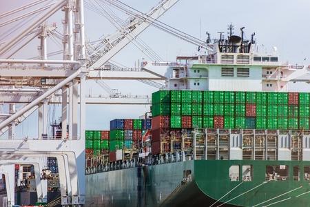 Unloading Cargo Ship in Port. International Shipping Destinations Theme. Stok Fotoğraf