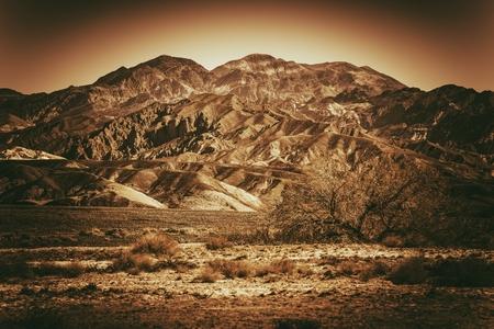 inhospitable: Inhospitable Desert Landscape in Death Valley California, United States. Browny Vintage Color Grading.