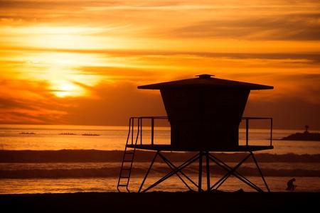 oceanside: Lifeguard Tower Sunset Silhouette Scenery. California, Oceanside Beach at Sunset. Stock Photo