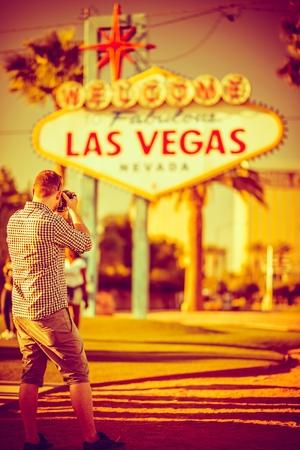 vegas: Photographer Taking Pictures in Las Vegas. Las Vegas, Nevada, United States. Warm Color Grading.