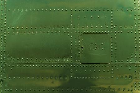 Rivets and Metal Dark Green Painted. Metal Military Grade Backdrop Stockfoto