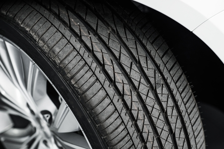 tire: Brand New Car Tire Closeup Photo. Modern Car Tire