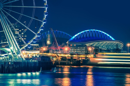 Seattle Waterfront and Illuminated Ferris Wheel at Night, Seattle, Washington, United States.