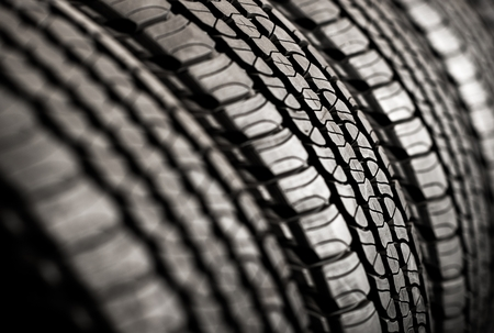 rack wheel: Brand New Tires For Sale. Car Tires Row on a Rack.