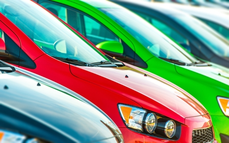 a lot  of: Cars Marketplace. Car Dealer Colorful Cars Stock. Stock Photo