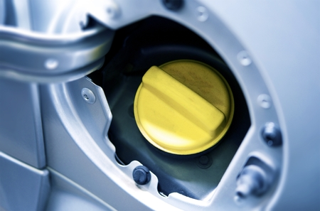 car gas: Yellow Cup of Car Fuel Inlet. Gas and Fueling Photo Concept.