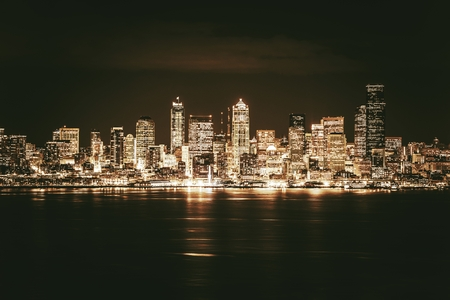 grading: Golden Seattle Skyline at Night. Seattle and the Puget Sound in Golden Brown Elegant Color Grading.