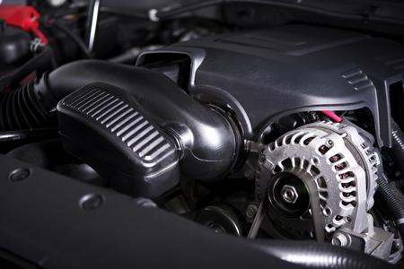 alternator: Modern Car Alternator and Gas Engine. Vehicle Engine Closeup. Stock Photo