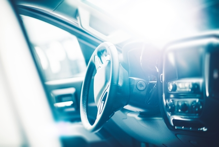 car loans: Modern Car Interior in a Bright Light. Transportation Theme. Stock Photo