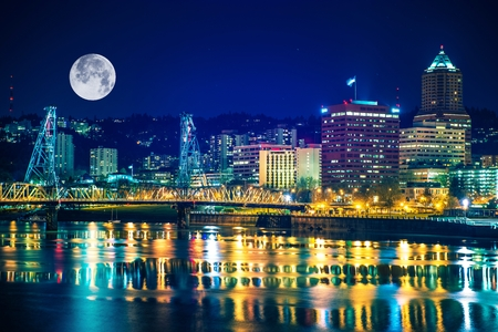 moon  metropolis: Portland Skyline with Moon and the Willamette River. Downtown Portland, Oregon, United States. Stock Photo