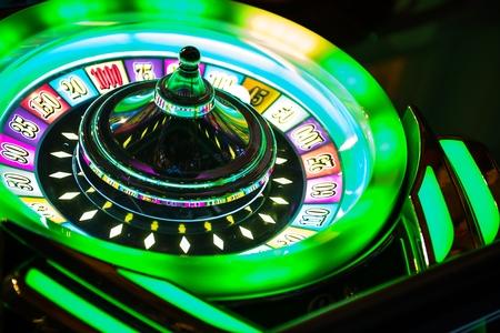 slot: Colorful Neon Illuminated Roulette Casino Game Closeup. Las Vegas Casino Games. Stock Photo