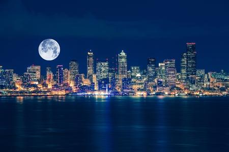 seattle skyline: Seattle and the Moon Night Skyline. Seattle, Washington, United States.