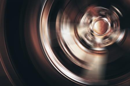 Spinning Car Wheel Closeup Photo. Car Alloy Wheel in Motion.