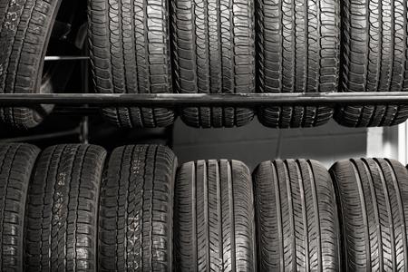 rack wheel: Large Metal Tires Rack. Modern Car Tire Service and Sale.