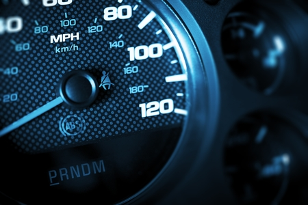 grading: Driving Speed Control. Car Tachometer Closeup. Dark Blue Color Grading. Stock Photo