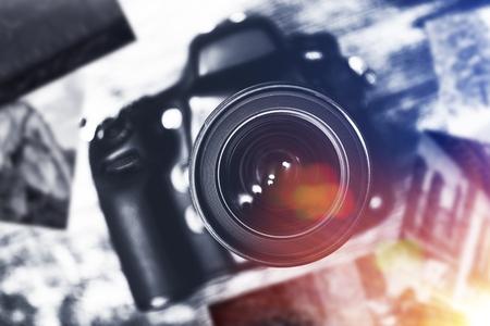 studio photography: Digital Camera and Prints on Table. Photographer Desk Concept.