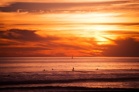surfers: Surfers and the Ocean. Southern California Ocean Sunset with Surfers Awaiting Big Wave. Stock Photo