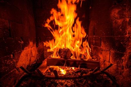 Burning Wood Logs Inside the Fireplace. Fireplace Heat.