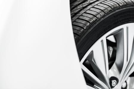 alloy wheel: New Car Tire Closeup Photo. Modern Car Alloy Wheel. Stock Photo