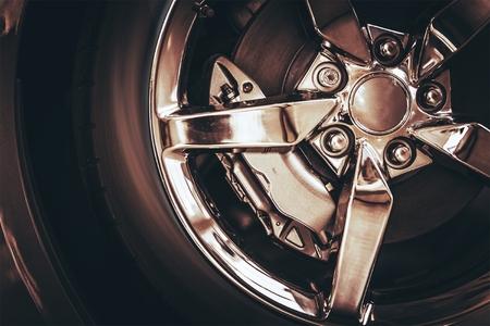 alloy wheel: Elegant Chrome Car Alloy Wheel Closeup Photo.