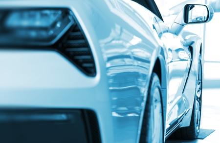 super car: Brand New Super Car For Sale. Blue Color Grading Transportation Concept.