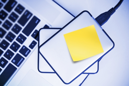 External Hard Drives Backup For Laptop. Small Portable Hard Drive with Yellow Sticky Paper Note. Mobile Workstation. Reklamní fotografie