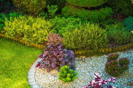 small garden: Rockery Garden Place. Small Rockery Garden Closeup Photo. Stock Photo