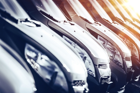Cars in Stock Closeup. Row of Brand New Cars For Sale. New Cars Industry. 스톡 콘텐츠