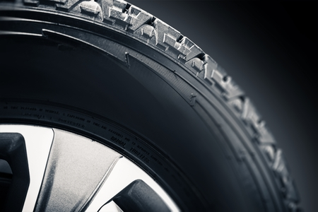 Off Road Tire and Alloy Wheel Closeup Photo. Stock Photo