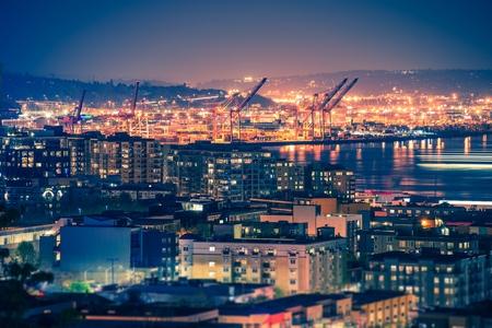 Port of Seattle at Night in Seattle, Washington, United States. Illuminated Cityscape and the Port.