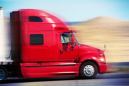 delivery truck: Red Semi Truck on the Road Stock Photo