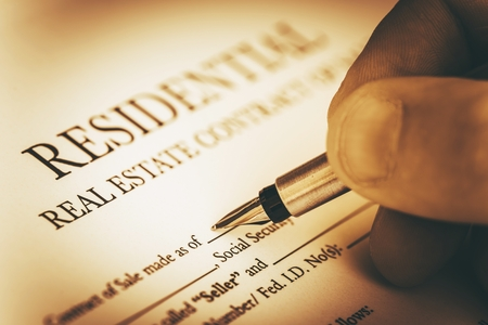 contracts: Signing Residential Real Estate Contract Closeup Photo Stock Photo