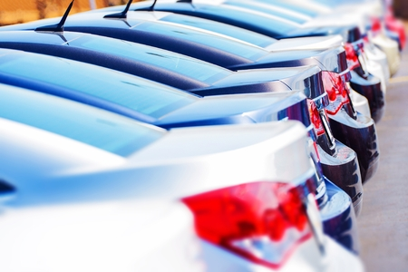 Row of New Cars in Stock. Rear Sides. Brand New Cars on the Dealer Lot Awaiting Clients. Reklamní fotografie
