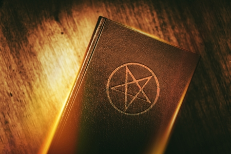 Old Mysterious Book with Pentagram Sign on the Cover.