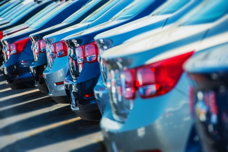 Row of New Cars on the Car Dealer Parking Lot Stock Photo