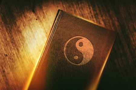 chinese philosophy: Taoism Symbol on the Book Cover. Stock Photo