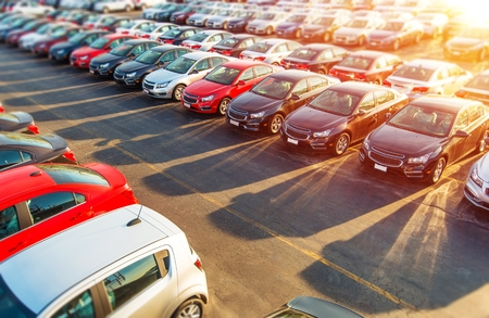 car model: Brand New Compact Vehicles For Sale Awaiting on the Dealer Parking Lot Editorial
