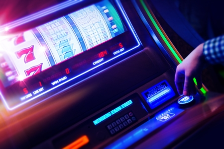 Casino Slot Machine Player Closeup Photo Stock Photo
