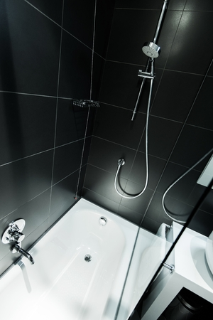 Genial Black Modern Bathroom Design. Bath Tube And Shower. Black Tiles. Stock  Photo