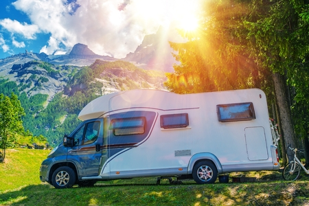 Camper Camping. Class B European Style Motorhome Caravan. Camper Van Trip. Summer RV Adventure. Stock Photo