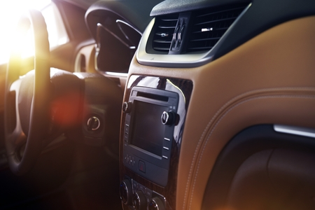 Modern Car Interior. Elegant Car Interior Design with Large Touch Screen Multimedia Device.
