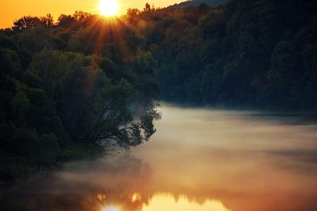 Scenic River Sunset. Foggy San River Scenery. Solina, Poland, Europe.